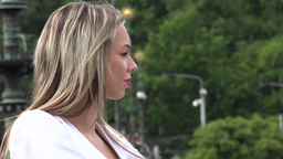 young attractive blonde woman looks around - closeup - shot from side Footage