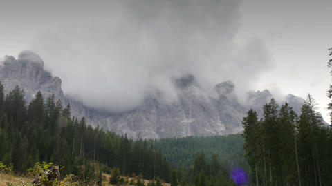 clouds around dolomites mountain summits time lapse 11725 Footage
