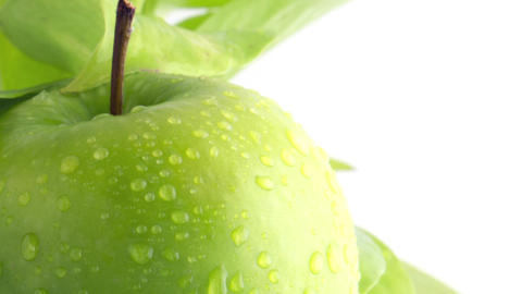 Drops of Rainwater on an Apple with Copy-space Footage