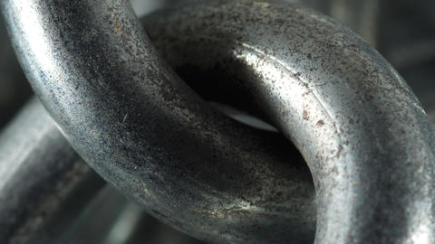 Closeup shot of a heavy industrial chain with links Bild