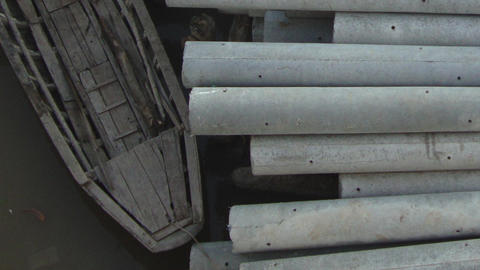 Concrete Pilings Ready for Transport by Traditional Asian Boat Footage