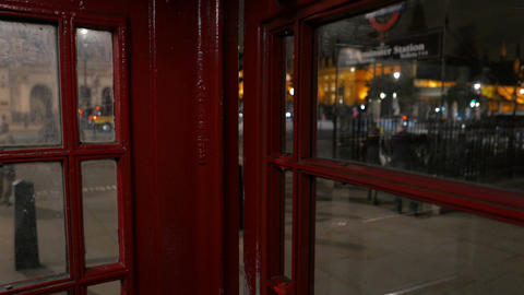 Westminster Seen From A Red Telephone Booth In London, England, UK stock footage