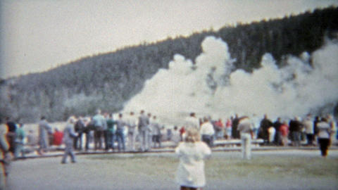 1959: Old faithful geyser in Yellowstone park family vacation visit Footage