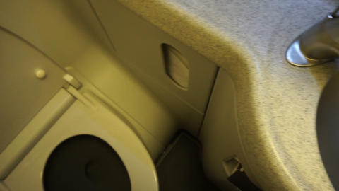 Interior Of Toilet Room In The Modern Aircraft stock footage