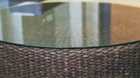Close Up Of Rattan Texture Horizontal Tracking Table With Glass Top Asian Interi stock footage