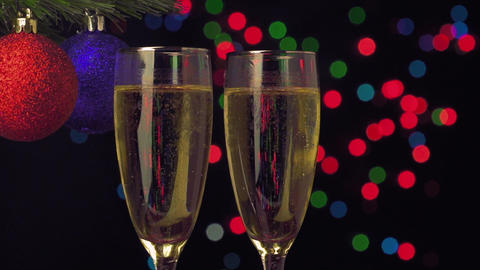 New Year and Christmas Celebration. Two Champagne Glasses over bokeh background Footage