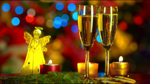 Christmas celebration with two champagne glasses Footage