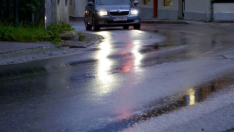 Car head light on wet street, abstract traffic rainy day Footage