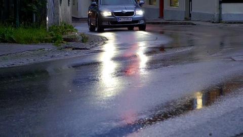 Car head light on wet street, abstract traffic rainy day Footage