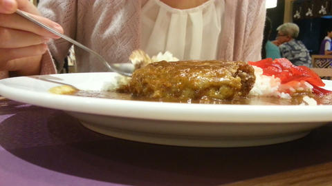 Eating Japanese food, hamburg with curry over rice. spoon and fork open up the m Footage