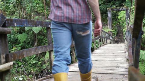 Man Walks on Hanging Bridge Going Footage