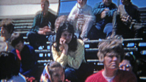 1963: Crowd seated watching high school track meet during bright summer day Footage