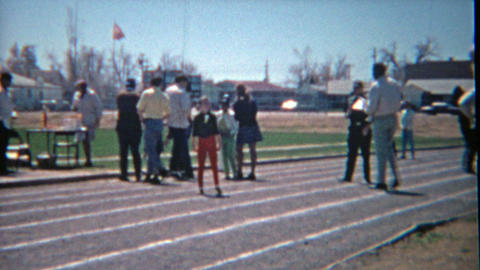 1963: Children running track race using informal clothing before the era of spor Footage