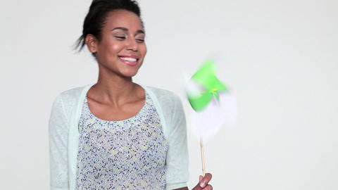 Young woman with spinning pinwheel Stock Video Footage