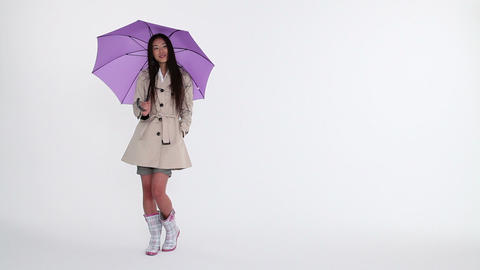 Woman with umbrella Stock Video Footage