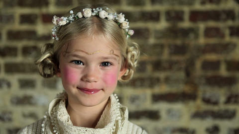 Young girl with flowers in her hair Stock Video Footage