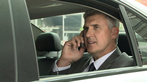 Businessman on cellphone in car Stock Video Footage