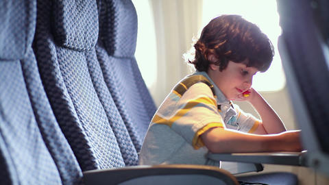 Young boy sitting on aeroplane Stock Video Footage