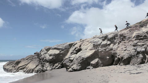 Group of young friends on cliff Stock Video Footage