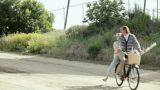 Couple riding a bicycle together Footage