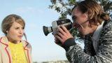 Man filming girlfriend blowing bubble gum Footage