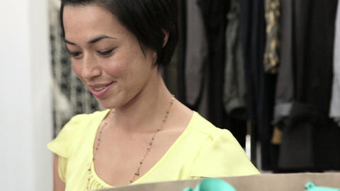 Sales assistant putting clothing in bag Stock Video Footage