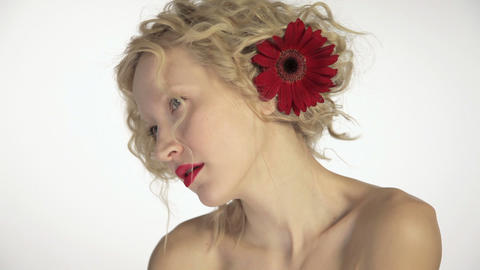 Beautiful young woman with flower in her hair Stock Video Footage