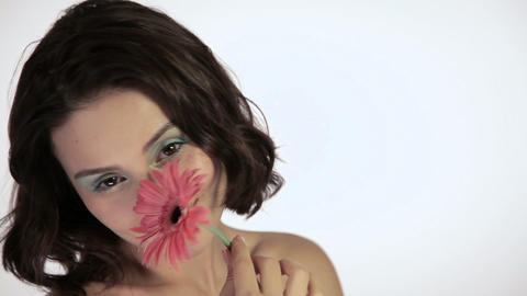 Beautiful young woman with flower Stock Video Footage