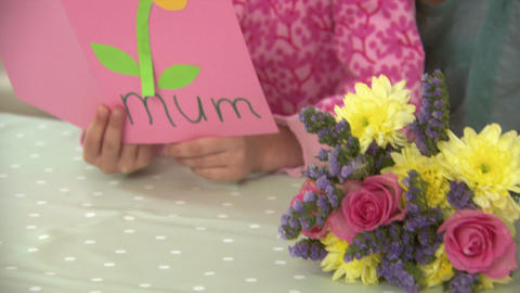 Girl and mother with flowers and mothers day card Stock Video Footage