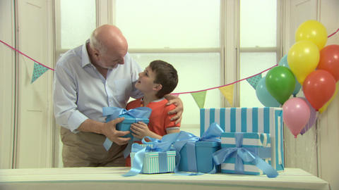 Man giving birthday gift to grandson Stock Video Footage