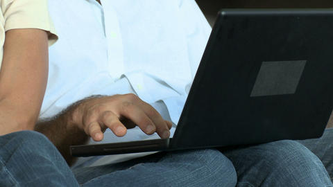 Couple using laptop Stock Video Footage