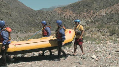 Group of people carrying raft Stock Video Footage