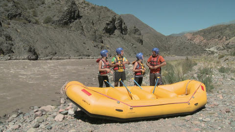 People ready for white water rafting, raising oars together Stock Video Footage