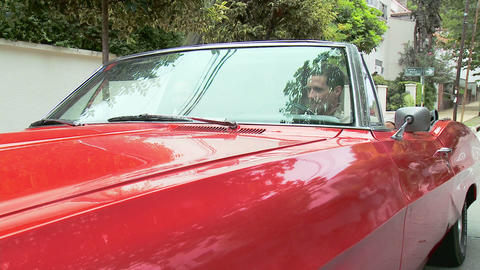 Young couple in convertible Stock Video Footage