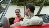 Young couple in convertible Footage