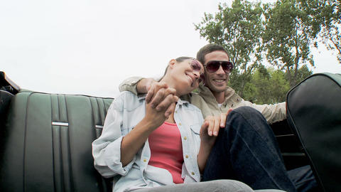 Young couple sitting on back seat of car Stock Video Footage