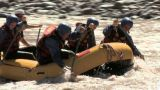 Rapids and group of people white water rafting Footage
