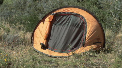 Couple opening tent and stretching Stock Video Footage