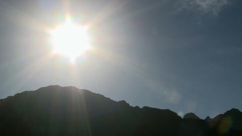 Sunlight over mountains Stock Video Footage