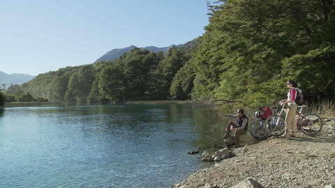 Couple by lake with bikes Stock Video Footage