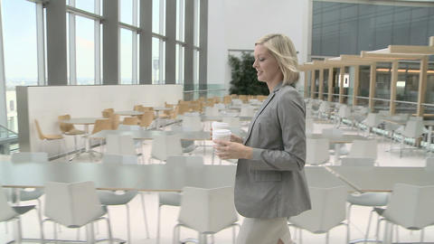 Businesswoman walking through canteen and joining... Stock Video Footage