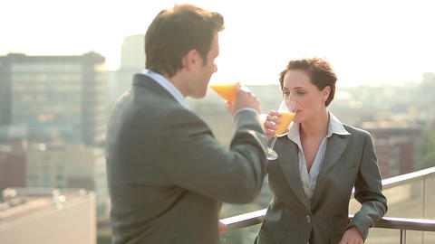 Businessman and businesswoman, toasting and drinking... Stock Video Footage