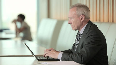 Businessman using laptop and looking at camera Stock Video Footage