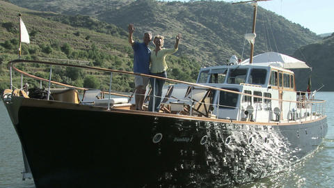 Senior couple waving from a boat Stock Video Footage