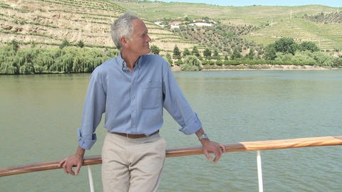 Senior man on a boat holiday Stock Video Footage