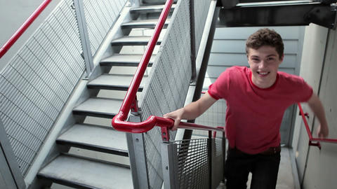 Young man running up stairs Stock Video Footage