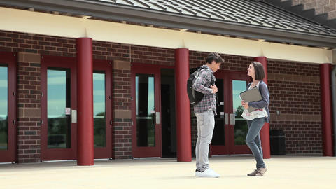 High school students outside school building Stock Video Footage