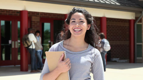 High school student outside school building Stock Video Footage