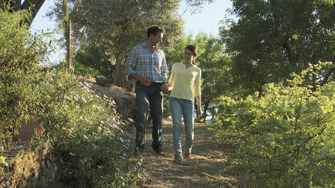 Couple taking a walk on holiday Stock Video Footage