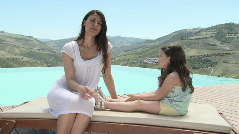 Mother and daughter sitting and talking on holiday Stock Video Footage